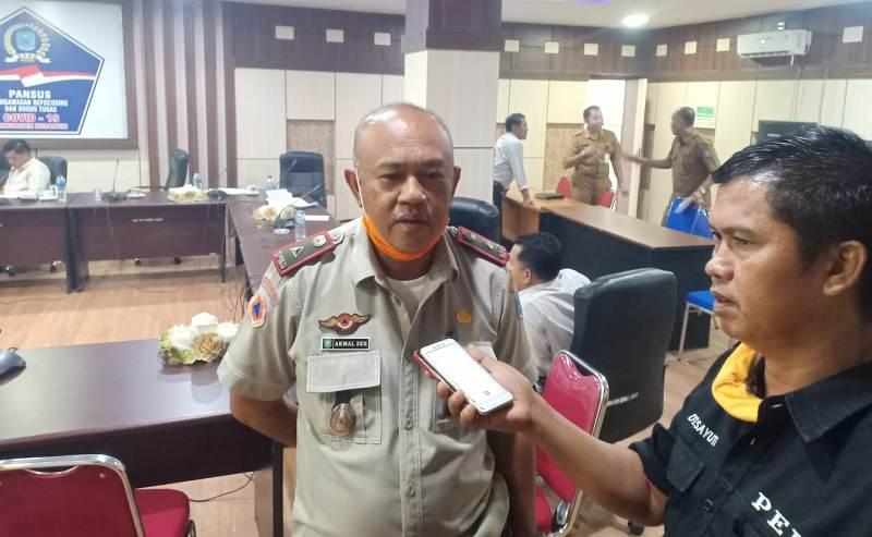 DINAMIKAJAMBI Bupati Merangin bilang sudah dibayar, Kepala BPBD Merangin sebaliknya, bilang 'nunggak' honor petugas posko Rp 360 juta.